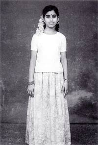 Mother Meera as a young girl standing